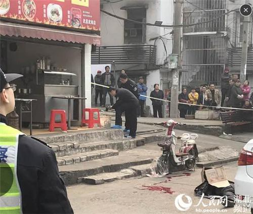 武昌火车站砍头事件 街头一男子头颅被砍 图片